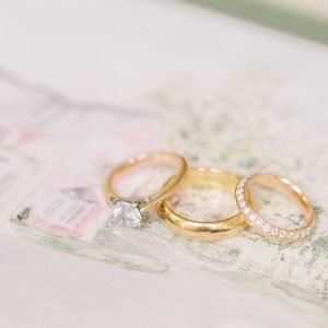 Close Up of S&N's Wedding Invitation & Rings